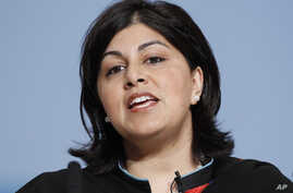 FILE - Britain's Chairman of the Conservative party Sayeeda Warsi speaks on the opening day of the Conservative party conference in Birmingham, England.