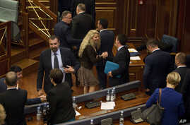 Kosovo lawmakers congratulate each other after the government lost a no-confidence motion during a parliamentary session in Pristina, Kosovo, on Wednesday, May 10, 2017.