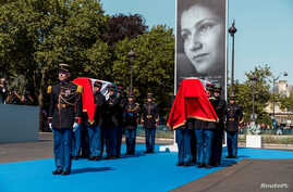 French Republican Guards carry the flag-draped coffins of late Auschwitz survivor and French health minister Simone Veil and her late husband Antoine Veil during a national tribute before being laid to rest in the crypt of the Pantheon mausoleum, in
