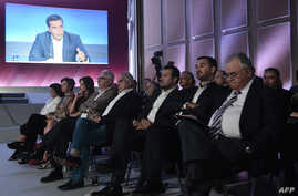 Ministers of the government watch the Greek Prime Minister Alexis Tsipras as he speaks during a press conference at the Thessaloniki International Fair (TIF) in Thessaloniki, northern Greece on Sept. 9, 2018.