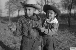 """Robert """"Corky"""" and Linda Poolaw (Kiowa/Delaware), dressed up and posed for the photo by their father, Horace. Anadarko, Oklahoma, ca. 1947. 45HPF57 © 2014 Estate of Horace Poolaw. Reprinted with permission."""