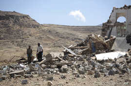 Forensic experts inspect the rubble of a house destroyed by a Saudi-led airstrikes on the outskirts of Sanaa, Yemen, Feb. 16, 2017.