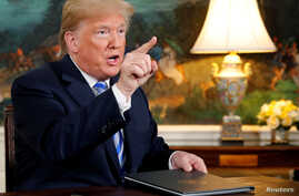 FILE - U.S. President Donald Trump speaks to reporters after signing a proclamation declaring his intention to withdraw from the JCPOA Iran nuclear agreement in the Diplomatic Room at the White House in Washington, May 8, 2018.