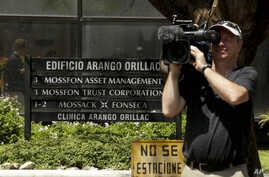 A cameraman films outside the Arango Orillac Building that lists the Mossack Fonseca law firm in Panama City, April 5, 2016. Millions of confidential documents were leaked from the firm, revealing details of how some of the globe's richest people fun
