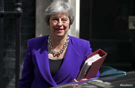Britain's Prime Minister Theresa May leaves 10 Downing Street in Westminster, London, Britain, July 18, 2018. An extremist loyal to Islamic State has been found guilty of plotting to kill May.
