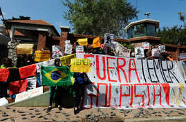 File -- Demonstrators protest outside the Olivos presidential residence against the visit of Brazilian President Michel Temer in Buenos Aires, Argentina, on October 3, 2016.