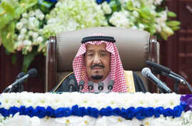 In this photo provided by the Saudi Press Agency, Saudi King Salman gives his annual policy speech in the hall of the  Shura Council, Nov. 19, 2018.