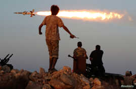 Fighters of Libyan forces allied with the U.N.-backed government fire a rocket at Islamic State fighters in Sirte, Libya, Aug. 4, 2016.