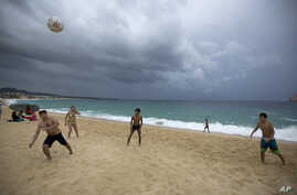 Mexico Tropical Weather Newton: People play on El Medano Beach before the arrival of Hurricane Newton in Cabo San Lucas, Mexico, Monday Sept. 5, 2016. Authorities at the southern end of Mexico's Baja California peninsula ordered schools closed and se