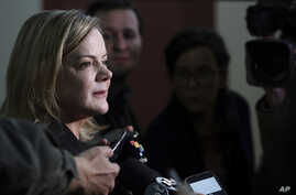 Workers' Party President Gleisi Hoffmann speaks to the press before the start of a Workers' Party National Executive members meeting to discuss the replacement of jailed presidential candidate, former President Luiz Inacio Lula da Silva, in Curitiba,