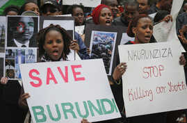 FILE - Burundi nationals from across the U.S. and Canada, along with supporters, demonstrate outside U.N. headquarters, calling for an end to political atrocities and human rights violations unfolding in Burundi under the government of President Pier