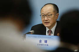 FILE - World Bank President Jim Yong Kim attends a news briefing after the Third Round Table Dialogue in Beijing, China, Nov. 6, 2018.