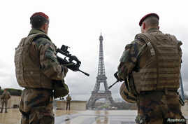FILE - French army paratroopers patrol near the Eiffel tower in Paris, France, March 30, 2016. French authorities are extending a state-of-emergency they imposed after the November 2015 terror attacks that killed 130 people.