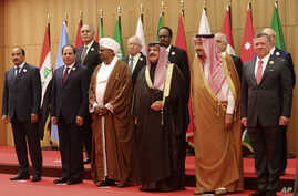 A section of twenty one kings, presidents and top officials from the Arab League summit pose for a group photo, at a gathering near the Dead Sea in Jordan, March 29, 2017.