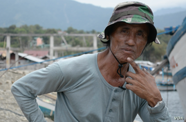 Macario Sepulveda, captain of the Prince John Paul fishing vessel, says his ship does do not go closer than a 55-kilometer radius from the Scarborough Shoal, March 24, 2014. (Simone Orendain/VOA)