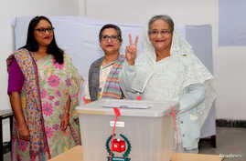 Prime Minister Sheikh Hasina gestures after casting her vote in the morning during the general election in Dhaka, Bangladesh, Dec. 30, 2018.