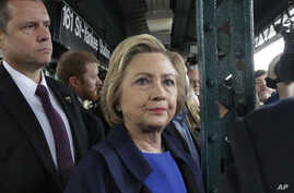 Democratic presidential candidate Hillary Clinton waits for a subway train at the 161St  - Yankee Stadium stop in the Bronx borough of New York, April 7, 2016.