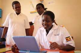 Rosemary Napeyok (right) in the Nadunget Health Center, located in Karamoja, northeastern Uganda, consults a doctor in Kampala over Skype, March 3, 2014. (Hilary Heuler for VOA News)