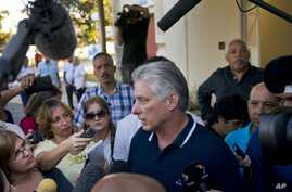 Cuba's President Miguel Diaz-Canel talks to the press after voting in a referendum to approve or reject the new constitution in Havana, Cuba, Sunday, Feb. 24, 2019.