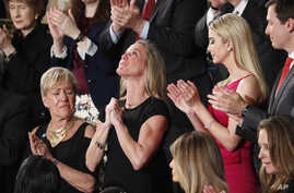 "Carryn Owens, widow of widow of Navy SEAL William ""Ryan"" Owens, is applauded on Capitol Hill in Washington, Feb. 28, 2017, as she was acknowledged by President Donald Trump during his address to a joint session of Congress."