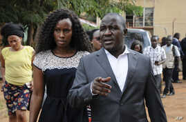 FILE - Wife Barbara Kyagulanyi of pop star and lawyer Asuman Basalirwa attempt to gain access to the military court trial of lawmaker, pop singer and prominent critic of Uganda's government Kyagulanyi Ssentamu, whose stage name is Bobi Wine, in Gulu,