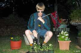 This undated photo taken from Lastrhodesian.com allegedly shows Dylann Roof.  The website, which surfaced after the murder of nine parishoners at an African American Church in Charleston, SC, also included a white supremacist manifesto.