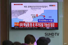 Visitors sit in front of the TV screen showing a news program reporting about North Korea's missile firing, at Seoul Train Station in South Korea, April 5, 2017. North Korea fired a ballistic missile into its eastern waters Wednesday.