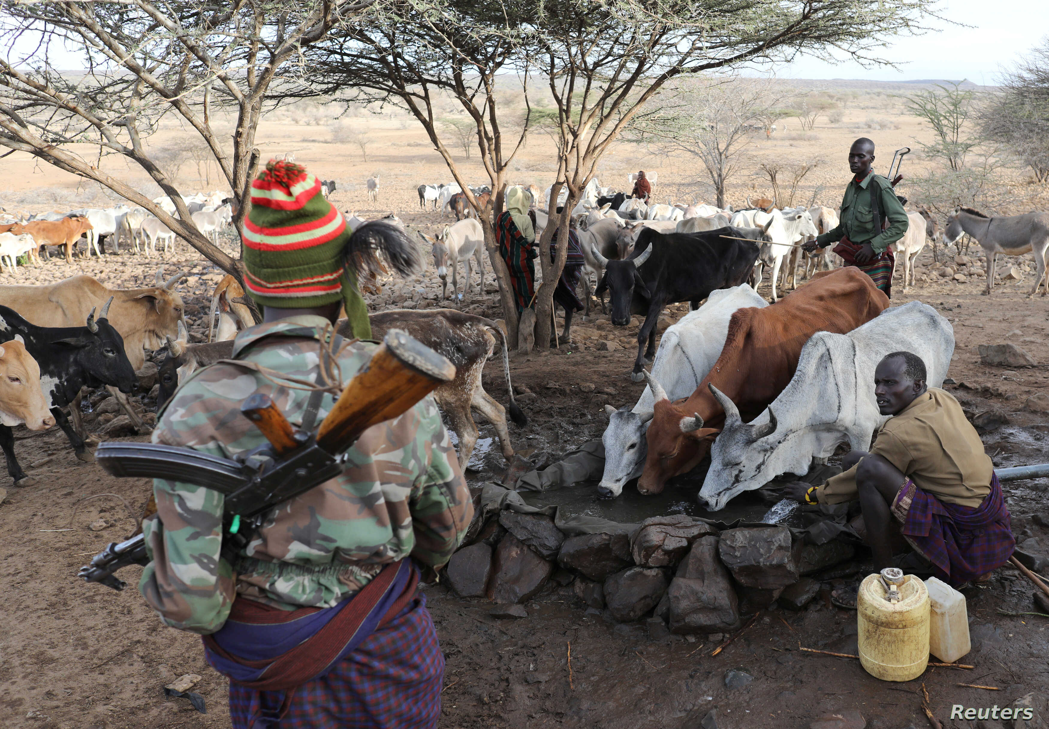 Turkana armed tribesmen stand around a borehole in order to protect their cattle from rival Pokot and Samburu tribesmen near Baragoy, Kenya, Feb. 14, 2017.