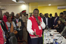 Presidential candidate Uhuru Kenyatta, address his supporters after receiving a clearance certificate from Chairman of Independent Electoral and Boundaries Commission for the presidential race, at Kenyatta International Conference Centre in Nairobi K...
