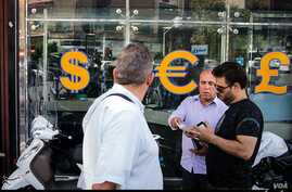An Iranian currency exchange shop appears in this photo published, Sept. 4, 2018, by Iran's Tasnim news agency, in a report about one of Tehran's main currency exchange streets.