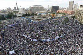 Thousands of Egyptians protest in Cairo's central Tahrir Square, the focal point of Egyptian uprising, as they hold banners and signs demanding prosecution of ousted president Hosni Mubarak and his regime Friday, April 8, 2011