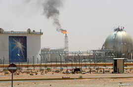 FILE - A gas flame is seen in the desert near the Khurais oilfield, about 160 km (99 miles) from Riyadh, Saudi Arabia, June 23, 2008.