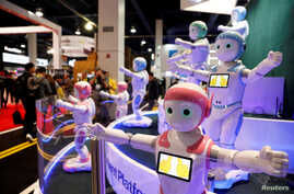 Avatarmind's iPal Smart AI Robots, designed to be companions for children and elderly, perform calisthenics.