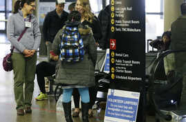 Volunteer law students talk to a traveler at a station near where international passengers arrive at Seattle-Tacoma International Airport, Feb. 28, 2017