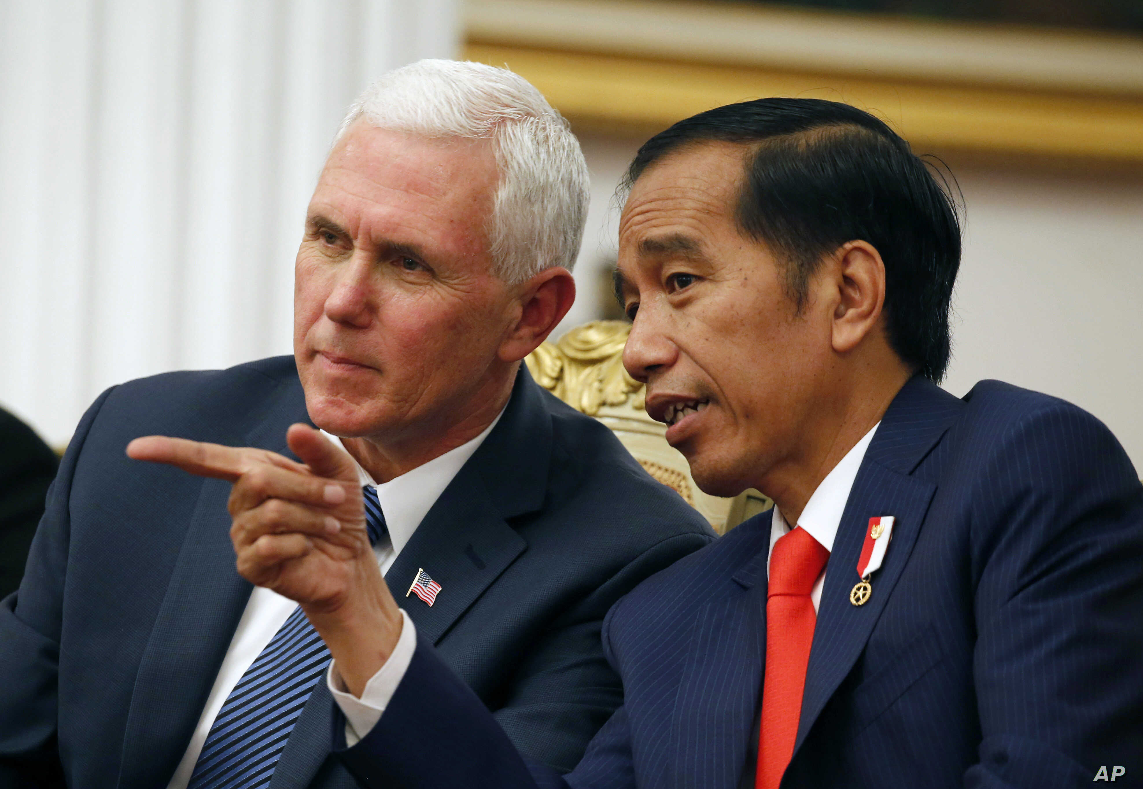 U.S. Vice President Mike Pence (left) talks with Indonesian President Joko Widodo during their meeting at Merdeka Palace in Jakarta, Indonesia, April 20, 2017. Pence is on a 10-day trip in Asia.