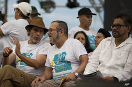 FILE - Rebel leaders Rodrigo Londono, center, Ivan Marquez, right, and Pastor Alape, left, attend the closing event of the 10th conference of the Revolutionary Armed Forces of Colombia, FARC, in Yari Plains, Colombia, Sept. 23, 2016.