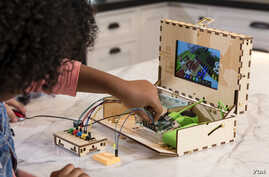 A child assembles an augmented reality computer kit created by Piper. A Chinese firm based in Silicon Valley helped fund the company. (Photo courtesy of Piper)