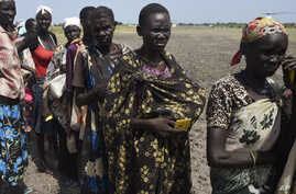 FILE - People queue for food being distributed in Unity state, South Sudan, Sept. 25, 2015.