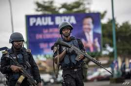 FILE - Members of Cameroon's security forces patrol in the South West province capital Buea, Oct. 3, 2018.