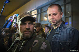 "FILE - Alexander Borodai (R), Prime Minister of the self proclaimed ""Donetsk People's Republic"", speaks with the media."