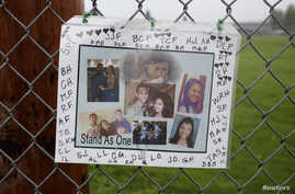 A makeshift memorial is seen outside Marysville-Pilchuck High School the day after a school shooting in Marysville, Washington, Oct. 25, 2014.