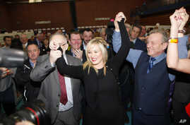 Sinn Fein's party leader for Northern Ireland Michelle O'Neill celebrates with party members Francie Molloy (left) and Ian Milne (right) after topping the poll in Mid Ulster, Ballymena count centre, Northern Ireland, March 3, 2017.