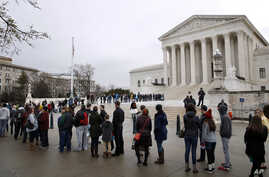 People stand in line to enter the Supreme Court, March 28, 2018, in Washington, where the court heard arguments on a gerrymandering case. The justices heard arguments in an appeal filed by Republicans in Maryland.