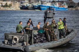 An Egyptian coast guard dinghy brings bodies from a Europe-bound boat that capsized off Egypt's Mediterranean coast, to the shore in Rosetta, Egypt, Sept. 22, 2016.