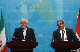 Iranian Foreign Minister Mohammad Javad Zarif, left, speaks during a news conference with Iraqi Foreign Minister Hoshiyar Zebari in Baghdad August 24, 2014