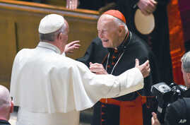 FILE - Pope Francis reaches out to hug Cardinal Archbishop emeritus Theodore McCarrick after the Midday Prayer of the Divine with more than 300 U.S. Bishops at the Cathedral of St. Matthew the Apostle in Washington, Sept. 23, 2015.