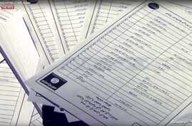 Documents identifying supporters of Islamic State are seen in this still image from video, released by Sky News to Reuters in London, March 10, 2016.