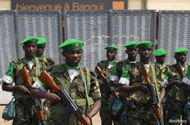 FILE - The first Rwandan soldiers who are part of the African Union peacekeeping force in the Central African Republic (MISCA) prepare to receive a welcome speech by their superiors shortly after landing at the airport of the capital Bangui.
