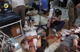 In this photo provided by the Syrian Civil Defense group known as the White Helmets, shows wounded men receiving treatment at a local clinic after airstrikes hit in Aleppo, Syria, Sept. 24, 2016.