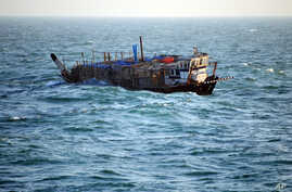 FILE - In this photo provided by the U.S. Navy, an Iran-flagged dhow is shown in the Persian Gulf. (AP)